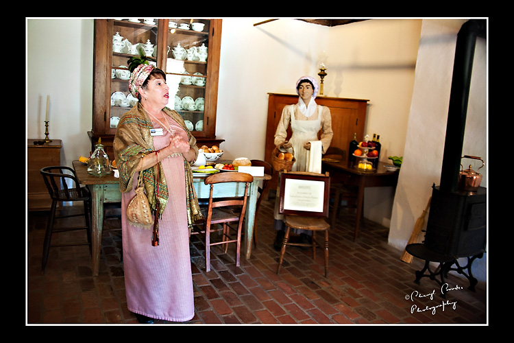 Beverly, one of Destrehan's historical interpreters, introduces visitors to Marguerite, repesented by the manniequin seen here in the background.
