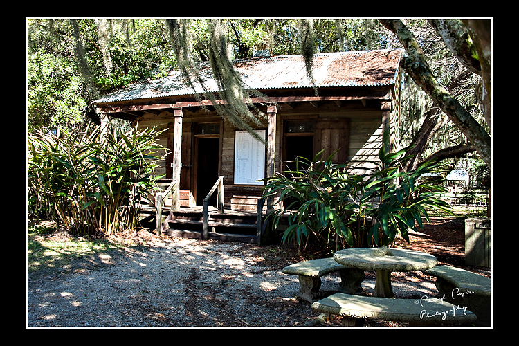 One of two slave cabins that sit near the main hoise. The slave registry can be seen posted on the front of the cabin.